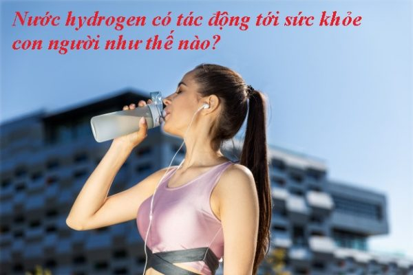 Woman With Ponytail Is Drinking From Sportive Bottle Earphones Near Modern Building 8353 10205